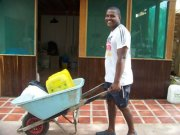The guys help bring salt water from the bay to flush our toilets. In the back is our laundry/cleaning supply room.
