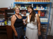 Swedish volunteer, Birgitta and Colombian volunteer, Martha work together in the pharmacy.