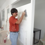 Jorge used metal framing, sheet-rock, stucco, and elbow grease to make the new wall.