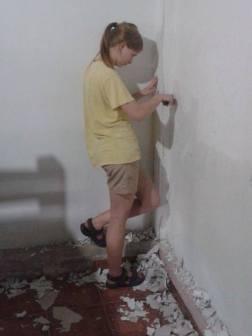 Scraping, repairing, and painting dorm room walls.