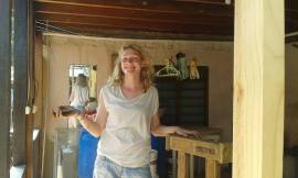 Ricarda sanding and helping to repair bed frames.